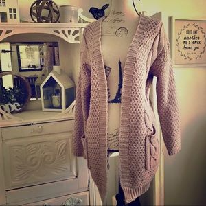Dusty pink cable knit cardigan.